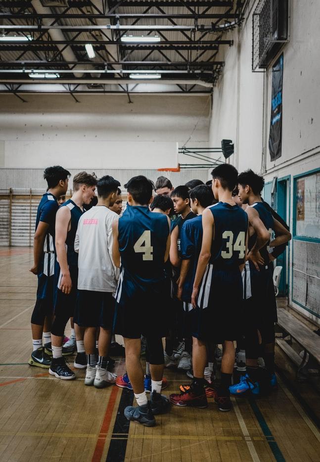 young athletes playing basketball